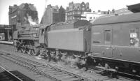 Britannia Pacific no 70001 <I>Lord Hurcomb</I> prepares to take an unidentified northbound train out of Carlisle platform 4 in July 1966. The locomotive was withdrawn from Kingmoor shed two months later.<br><br>[K A Gray&nbsp;02/07/1966]