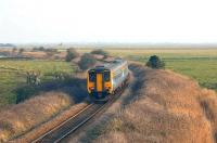 A DMU crossing Halvergate Fens near Acle between Great Yarmouth and Norwich in 2006.<br><br>[Ian Dinmore //2006]