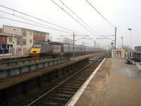 43304 is the rear power car on the 09.23 CrossCountry HST departure to Plymouth seen leaving Wakefield Westgate on a misty March morning.<br><br>[David Pesterfield&nbsp;05/03/2013]