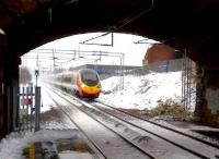 A Pendolino (destination unknown) heading East, about to pass through Adderley Park station at speed on 24 March. Notice the icicles hanging from the road bridge.<br><br>[Ken Strachan&nbsp;24/03/2013]