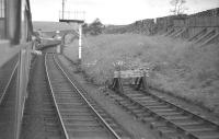Passing the snow fences on the southern approach to Dent station. Photograph taken from the down RCTS 'Borders Railtour' ex-Leeds City on 9 July 1961. Locomotive 46247 <I>City of Liverpool</I> can just be seen at the head of the train.<br><br>[K A Gray 09/07/1961]