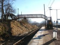 The unusual curved split-level footbridge at Rannoch Station, seen looking south during a station stop on 19 February 2013.<br><br>[David Pesterfield&nbsp;19/02/2013]