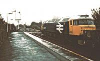 A PW train stands patiently in pouring rain at the north end of Appleby station in 1983. 47467 is awaiting permission to access the Eden Valley line.<br><br>[Ian Dinmore&nbsp;//1983]