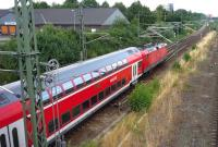 A DB <I>Regio</I> double-deck service from Hamburg runs through the eastern suburbs of Lubeck in the summer of 2010.<br><br>[John Steven&nbsp;27/07/2010]