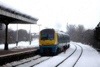 The 09.21 Cardiff - Holyhead service, formed by unit 175003, leaves a snow covered Wrexham General during a snowfall just after mid-day on 27 March 2013. <br><br>[David Pesterfield&nbsp;27/03/2013]