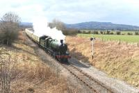 Ex-GWR 2-8-0 no 2807 with a train at Didbrook on the Gloucestershire Warwickshire Railway on 29 March 2013. <br><br>[Peter Todd 29/03/2013]