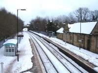 A near 150mm layer of snow has almost engulfed Ruabon Station. View north towards Wrexham from the station footbridge on 27 March 2013.<br><br>[David Pesterfield&nbsp;27/03/2013]