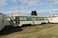 Blackpool <I>Centenary</I> car 643 was repainted in a traditional Blackpool Transport green and cream livery for its role as the site reception office/shop at Broadwater caravan park. In this livery it fitted in to its surroundings much better than it did on arrival in 2012 [See image 40276] but in early 2014 it was deemed surplus to requirements and removed from the site.<br><br>[Mark Bartlett&nbsp;29/03/2013]