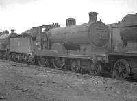 Pickersill 4-4-0 no 54472, thought to have been photographed in the sidings alongside Corkerhill shed in 1959, the year of its withdrawal. [With thanks to Messrs Robin, Smith, Jamieson and Mackie]<br><br>[K A Gray&nbsp;//1959]