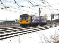 A Northern Class 142 heads south at Farington Junction on a Blackpool to Manchester Victoria service on a cold 23 March 2013.  On the left is the Leyland Trucks factory.<br><br>[John McIntyre&nbsp;23/03/2013]