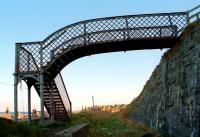 The footbridge at Buckpool in 1997, looking east along the former Moray Coast line towards Buckie.<br><br>[Ewan Crawford&nbsp;//1997]