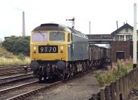 Brush Type 4 No 1547 passes Wath Central signal-box on the eastern approach to Wath Yard in July 1971 with a lowly class 9 trip working of 16T mineral wagons. A bit of a comedown from the previous occasion I had photographed the loco just over a year earlier passing through Larbert on an up Motorail service [see image 35785].<br><br>[Bill Jamieson&nbsp;21/07/1971]