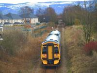 The 1700 Perth - Edinburgh passing the site of Bridge of Earn station<br> on 4th April 2013.<br><br>[Brian Forbes&nbsp;04/04/2013]