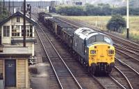 6733 leaves Wath Yard heading east with a partially fitted train of assorted loaded coal wagons. When this photograph was taken in 1971 the yard had less than 20 years of operational life remaining, with complete closure coming in 1988 along with the demise of the last of the local collieries.<br><br>[Bill Jamieson&nbsp;21/07/1971]