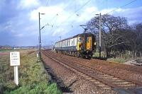 A rare sight away from the Thorpe-le-Soken to Walton line by February 1977, a two car Class 309 unit photographed shortly after passing through Hythe, running ecs from Ilford carriage sidings towards Clacton.<br><br>[Mark Dufton&nbsp;22/02/1977]
