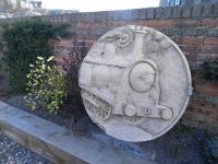 This roundel of a J36 - appropriately the last working class of steam <br> locomotive in Scottish mainline service, and based in Fife - by local <br> sculptor Kenny Munro now decorates the station car-park which has been <br> landscaped by the Kinghorn Station Studios and Gallery. [See image 23043]<br><br>[John Yellowlees&nbsp;09/04/2013]