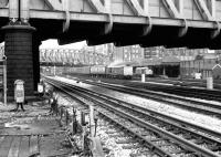 Looking across LT and BR lines from Royal Oak Hammersmith & City Line station towards Paddington parcels depot in September 1979. A class 31 is manoeuvering vans while another stands at the parcels platform. Part of the main line station can be seen in the left background. Paddington parcels depot closed during the 1980s. [See image 36915] <br><br>[John Furnevel&nbsp;14/09/1979]