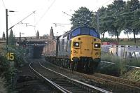 In the 1970s, apart from holiday excursions, the only regular diesel hauled train on the Colchester - Clacton line was the early morning newspaper service which ran every day except Sunday. It is seen here at 6.30am on 7th July 1979 passing under Cowdray Avenue in Colchester on its return leg. In the foreground are the points for the <I>flyunder</I> junction to the main line.<br><br>[Mark Dufton&nbsp;07/07/1979]