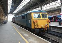 The last mainline registered Class 87 being towed south for probably the last time on 11 April 2013. 87002, which had been performing ice-breaking duties based at Carlisle during the past few months, was photographed being hauled south through Preston station by 47245. [See image 16478] <br><br>[John McIntyre&nbsp;11/04/2013]