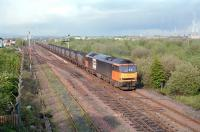 A coal train approaching Fouldubs Junction from Grangemouth docks in 1997 behind Loadhaul liveried 60025. <br><br>[Ewan Crawford&nbsp;//1997]
