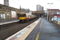 318261 calls at platform 1 at Motherwell with a Lanark service on 2 January 2008.<br><br>[John McIntyre&nbsp;02/01/2008]