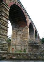The northern end of Newbattle Viaduct on the Waverley route, looking south towards Newtongrange on 12 April 2013. This is the point where the 23-arch structure spans the South Esk, running just beyond the wall in the foreground. [See image 33036]<br><br>[John Furnevel&nbsp;12/04/2013]