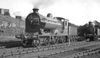 Preserved NBR 4-4-0 no 256 <I>Glen Douglas</I>, photographed on Dawsholm shed in September 1959. This was one of a number of preserved locomotives used to haul specials in connection with the Scottish Industries Exhibition being held in Glasgow at that time [see image 34225]<br><br>[K A Gray&nbsp;/09/1959]