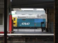 Riviera Trains large logo liveried blue 47847 is framed by platform 12 buildings as it stands on the west side of Crewe Station during coaching stock shunting activities in April 2013.<br><br>[David Pesterfield&nbsp;16/04/2013]