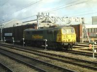 Freightliner 86607 is stabled on a short rake of intermodal flats alongside Arriva's London and North Western maintenance facility located between the West Coast and Alsager lines south of Crewe Station on 16 April. <br><br>[David Pesterfield&nbsp;16/04/2013]