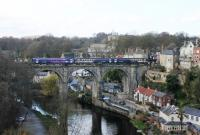 Performing the hourly ritual of reversing onto the viaduct at Knaresborough and then setting back into the station is a Northern 153/155 Sprinter combination. Every other train from Leeds terminates here with the alternates continuing to York. The quirky signalbox is on the right overlooking the bridge.<br><br>[Mark Bartlett&nbsp;19/04/2013]