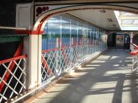 The footbridge at Chester has undergone recent improvement with a copper finish skirting and low level tubing installed along each side. The over track section has also had glazing erected on both sides as wind protection.<br><br>[David Pesterfield 16/04/2013]