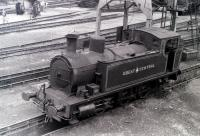 Scene at Steamtown, Carnforth, in 1975. Preserved 0-6-0T in GCR livery - details unknown.<br><br>[Colin Miller&nbsp;//1975]