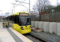 A Manchester Metrolink tram arriving at St Werburghs Road on 23 April 2013. Opened in July 2011, the tram stop is built on the former CLC route which closed to passengers in 1967. Much of the structure stands on an area formerly occupied by Chorlton Junction signal box.<br><br>[John Yellowlees&nbsp;23/04/2013]