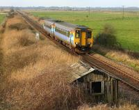 A train for Great Yarmouth approaching Stracey Arms, near Acle, Norfolk, in February 2006.<br><br>[Ian Dinmore /02/2006]