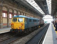 Scene at Preston station on 11 April 2013, with  WCRC 47245 hauling 87002, the last mainline registered Class 87 locomotive, on its way from Carlisle to Willesden. <br><br>[John McIntyre&nbsp;11/04/2013]