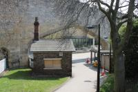 Alongside York's city walls, and the pedestrian entrance to George Stephenson House (Network Rail HQ), is this unmistakable former railway hut. The arch in the background was created so that trains could pass through the wall to the original Y&NM terminus, later replaced by York's present day through station.<br><br>[Mark Bartlett&nbsp;20/04/2013]