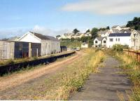 Scene at Instow, North Devon, on the Barnstaple - Torrington line. View north towards the level crossing in 1990. Instow station closed to passengers in 1965, with the line from Barnstaple closing completely in 1982. [See image 19737] [With thanks to all who responded to this query]   <br><br>[Ian Dinmore&nbsp;//1990]