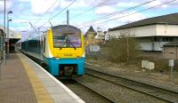 Arriva 175008 on a Manchester Piccadilly to Llandudno service leaves Warrington Bank Quay on 18 April.<br><br>[Ken Browne&nbsp;18/04/2013]