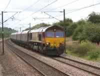 Tursdale Junction on the ECML between Darlington and Durham is where the line from Stockton joins. 66151 heads north with an empty coal train on 30 August 2010, as seen looking south from a train on the Stockton line.<br><br>[John McIntyre&nbsp;30/08/2010]