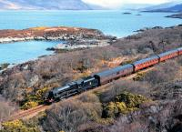 Friday the 26th of April brought heavy frequent showers of sleet and rain to the Highlands. Here the sun makes a rare appearance as Black 5 no 45407 hauls the <I>Great Britain VI</I> west of Duirinish on the way to Kyle of Lochalsh, with Loch Kishorn in the background. <br><br>[John Gray&nbsp;26/04/2013]