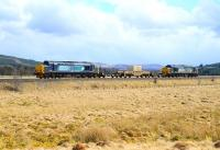DRS class 37s nos 37259 and 37608 top and tail the nuclear flask train across the moors at Moy on the way north to Georgemas Junction on 1 May 2013.<br><br>[John Gray&nbsp;01/05/2013]