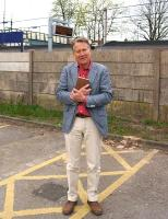 With Bradshaw in hand whilst filming in the North-West, Michael Portillo stands at Leyland on a rather dull Friday evening. The film crew had packed up and were about to move off when he kindly agreed to pose for one more photo after a long day on the road. He told me that he was making a programme on the railways around Manchester. <br> <br><br>[John McIntyre&nbsp;04/05/2013]
