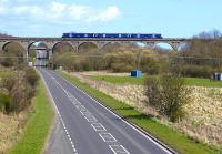 A Saltire-liveried 170 heads south over Markinch viaduct. View east on 29 April. <br><br>[Bill Roberton&nbsp;29/04/2013]