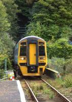 Emerging from Aberdovey tunnel number 3 into Penhelig station on 17 August 2011.<br><br>[Ian Dinmore&nbsp;17/08/2011]