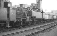 Fowler ex-LMS 2-6-2T no 40022 on shed at Kentish Town (14B) in October 1962. Nearest the camera is 3F 0-6-0T 47202 (of 1899 vintage). Both locomotives are fitted with condensing apparatus for operating over the Metropolitan widened lines.<br><br>[K A Gray&nbsp;28/10/1962]