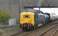 Deltic D9000 <I>Royal Scots Grey</I> with the 6Z54 Brodie Works to Glasgow Works EMU drag, seen leaving Barassie sidings with 334025 in tow shortly after running round.<br><br>[Ken Browne&nbsp;04/05/2013]
