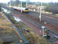 A Lanark - Dalmuir train heads north at Law Junction on 15 December 2002. [See image 6629]