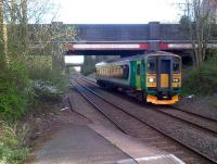 The 18.53 service to Nuneaton approaches Bedworth through encroaching vegetation on Friday 26th April. <br><br>[Ken Strachan 26/04/2013]