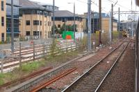 Approaching Haymarket by train on 6 May, with the tramway on the left (with loop) and 156506 standing in platform 0.<br><br>[Bill Roberton&nbsp;06/05/2013]