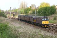 Seeing a Class 33 on the main line is fairly rare these days but two together is a special event. WCRC 33207 and 33029 head south of Farington Curve Jct on the WCML with the 5Z42 Carnforth to Southall ecs move on 7 May 2013.<br><br>[John McIntyre&nbsp;07/05/2013]